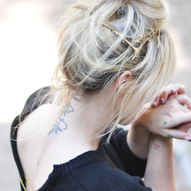 neck tattoo, messy bun, gold twig hair pins