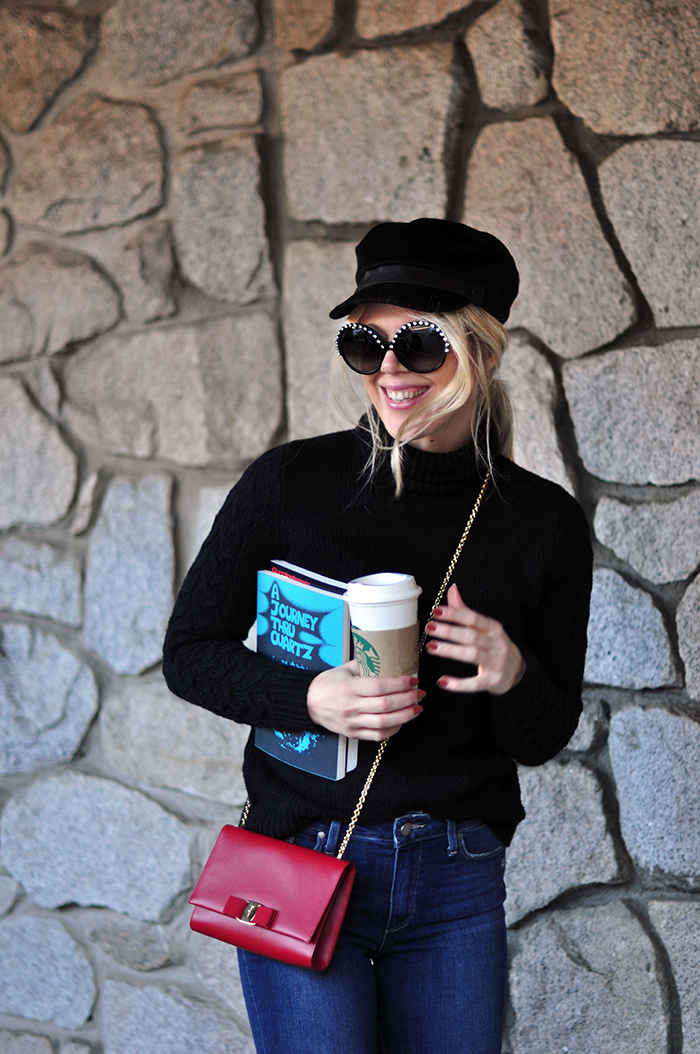 retro casual 60s style, big round embellished sunglasses, jeans and a turtleneck, red cross body bag, loafers, casual street style
