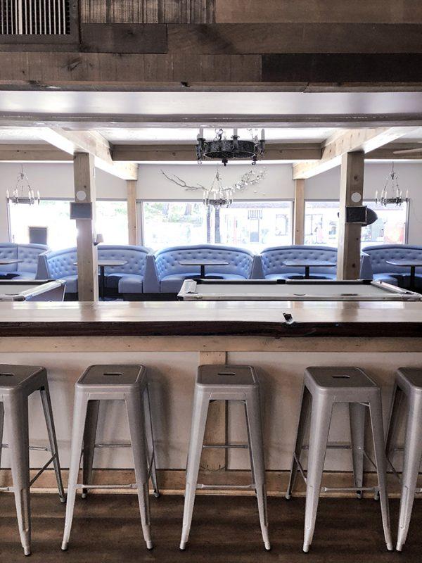 Dogwood Tavern, bar in lake arrowhead, film location, rustic modern, metal stools, blue booths