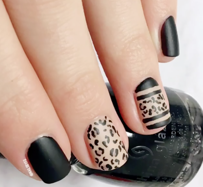 classic matte black manicure with leopard print accent nails