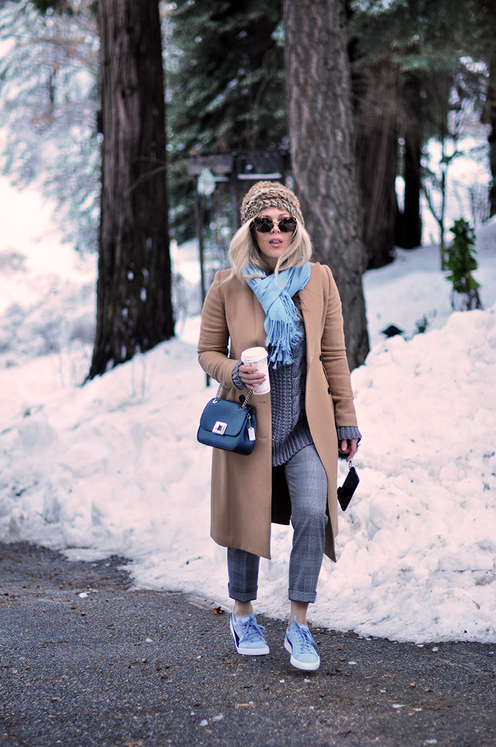 winter style in the snow, camel coat, plaid pants, sneakers with everything, love maegan tintari