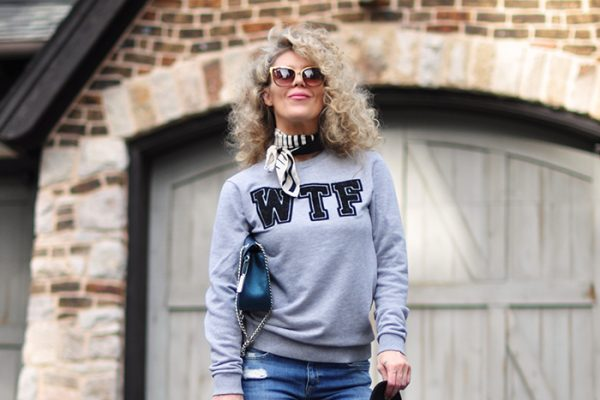 casual style-WTF-sweatshirt -bootcut jeans-hat-big curly blonde hair - love maegan tintari