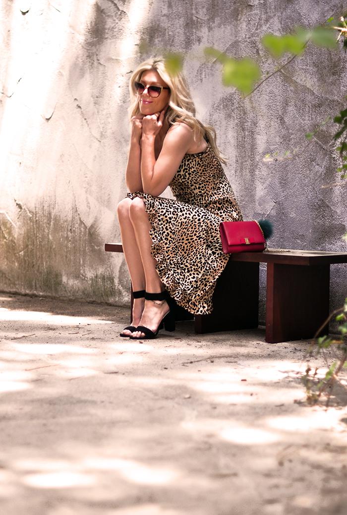 leopard slip dress with red bag and ankle strap heels - love maegan tintari