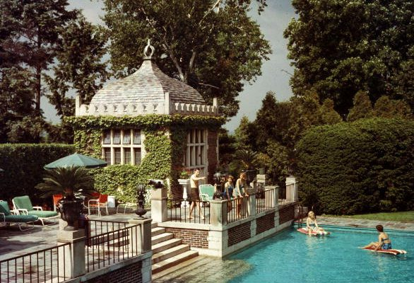 circa 1960:  Mrs A Watson Armour III (Jean Schweppe) with friends and family enjoying the pool on their estate at Lake Forest, Illinois.  A Wonderful Time - Slim Aarons  (Photo by Slim Aarons/Getty Images)