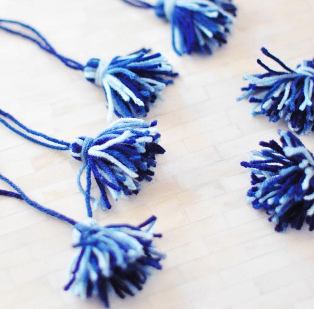 DIY little yarn tassels in blue