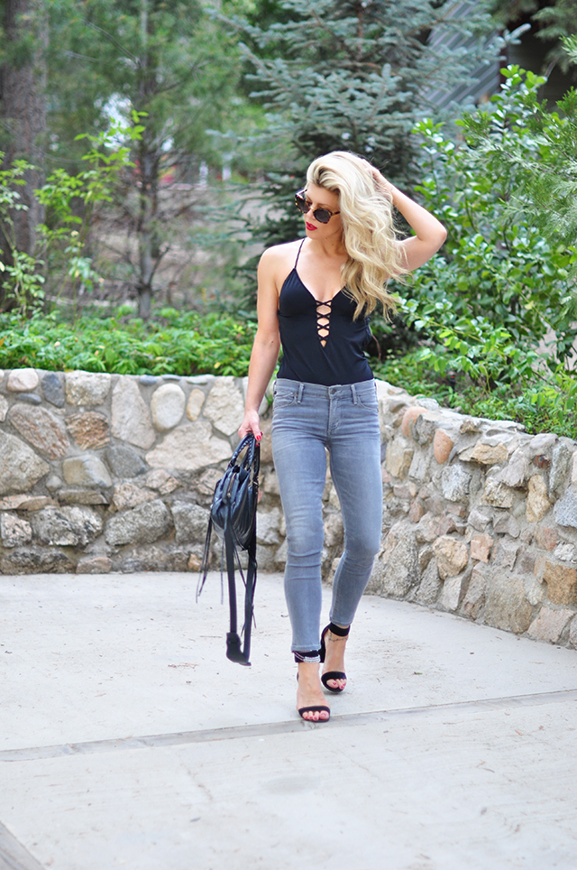 Grey jeans with a one piece bathing suit