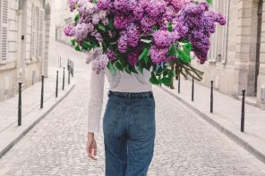 Girls Carrying Bunches of Flowers… in front of their face