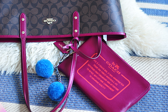 Reversible coach tote bag with pom pom bag charm and pouch