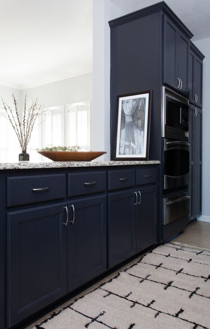 Stone-Textile_Kitchen_island - navy blue cabinets