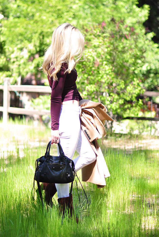 White jeans_balenciaga bag_camel coat_burgundy lace up top