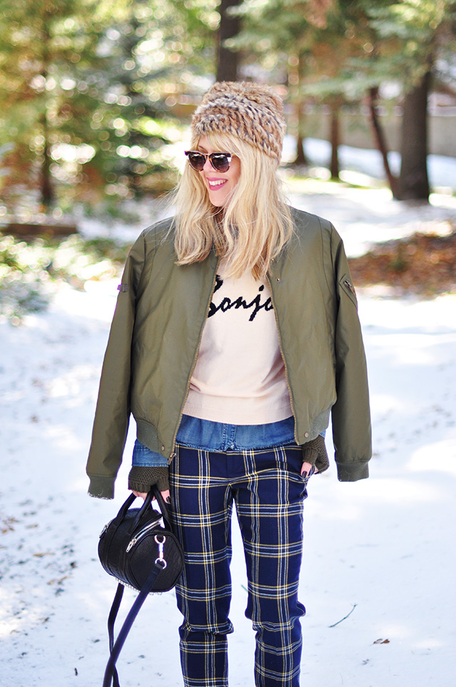 army green flight jacket_plaid pants_winter outfit in the snow