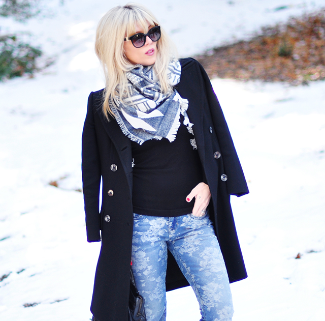 blue and black outfit in the snow
