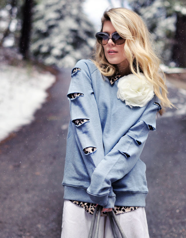 blue slashed sweatshirt with big flower pin and leopard print sleeves