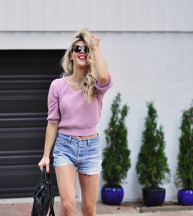 cut off denim shorts and pink sweater