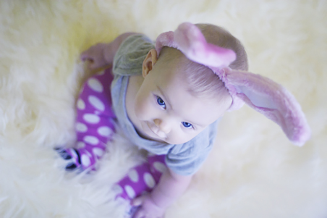 cute baby with bunny ears for easter