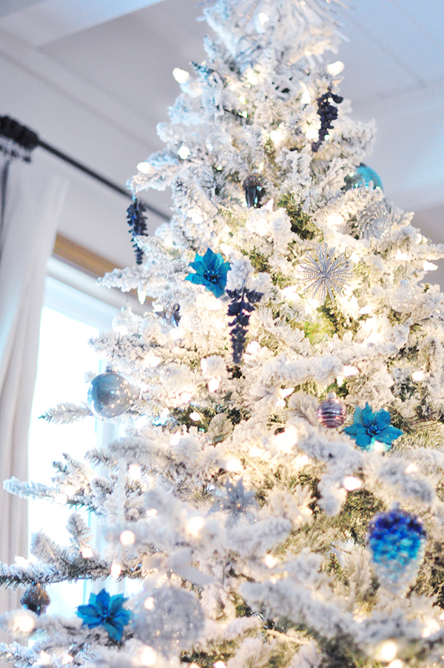 flocked christmas tree with teal and silver ornaments