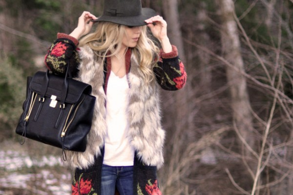 fur vest-printed cardigan- jeans-t shirt-hat