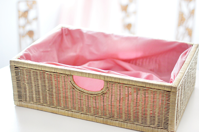 gold basket with pink fabric liner