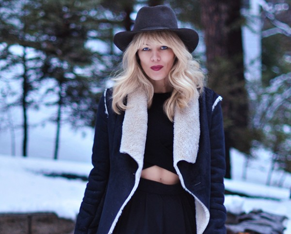 hat and shearling in the snow