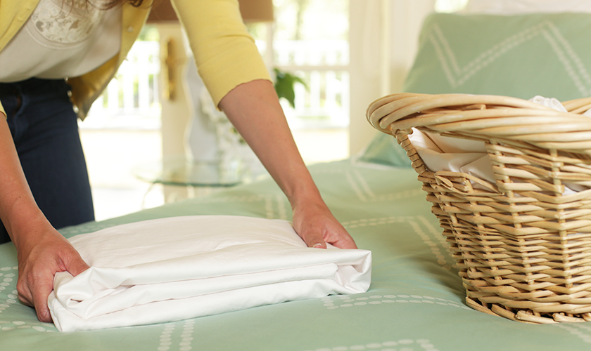how to fold a fitted sheet perfectly in seconds