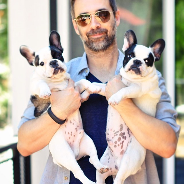 husband with puppies