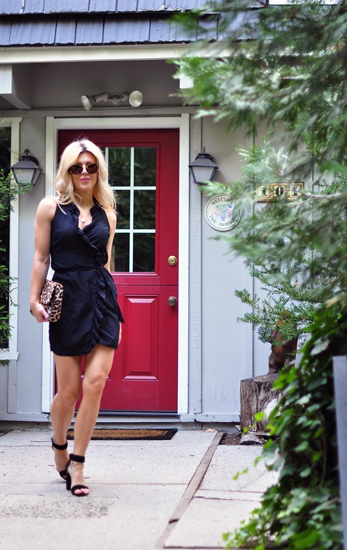 little black wrap dress with ruffle - leopard bag
