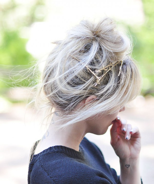 messy hair bun+bangs+twig pins