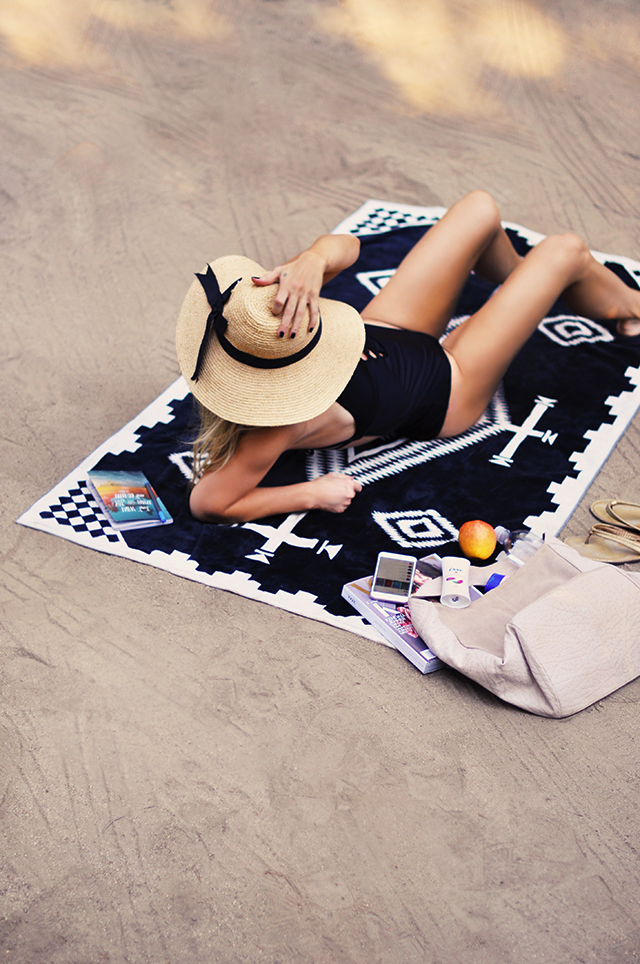 on the beach on the sand _one piece bathing suit_summer hat_pendelton towel