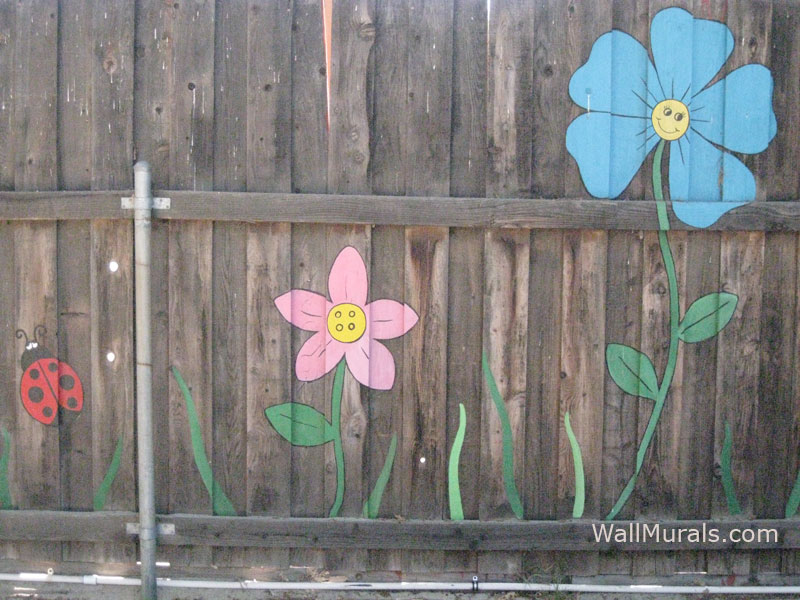 flower painted backyard fence