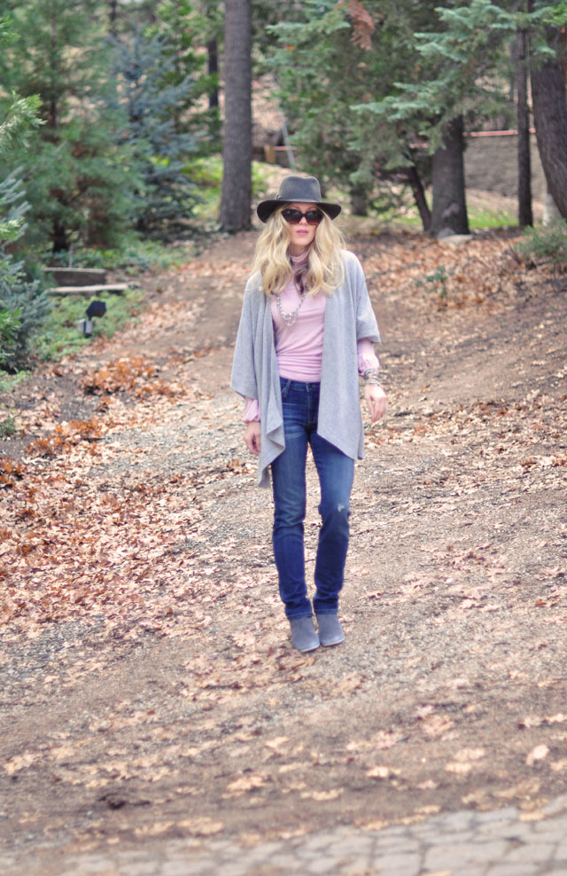 poncho-hat-pink turtleneck-jeans