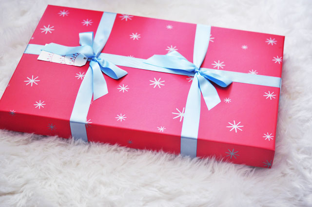 red holiday box with blue ribbon