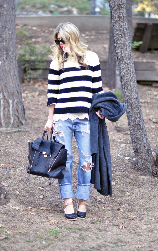 ripped Levis jeans-striped sweater- 31 phillip lim bag
