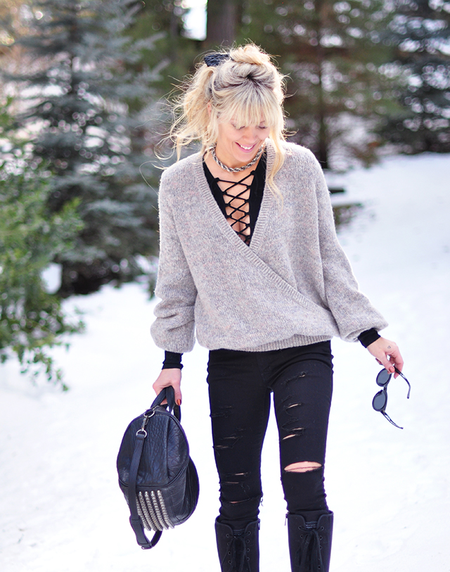 ripped black jeans_lace up top_snow style