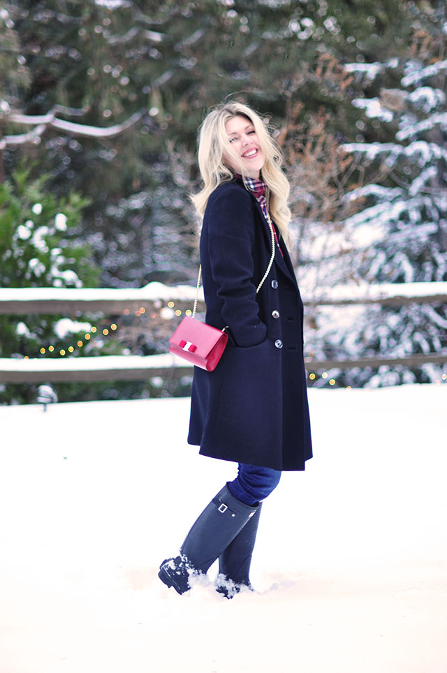 vintage coat  and hunter boots in the snow
